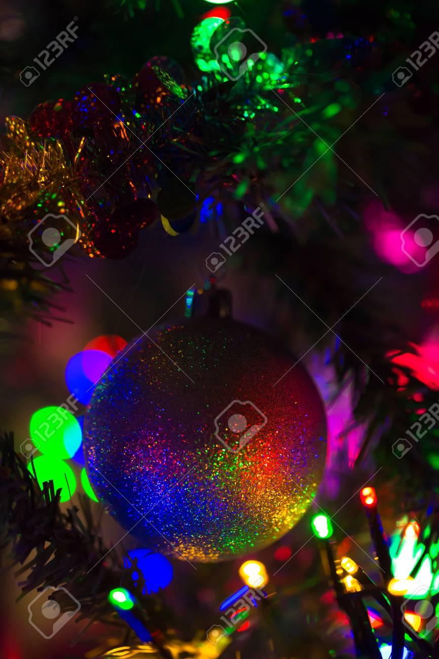 Magical Rainbow Christmas Ball Hanging On A Christmas Tree Christmas