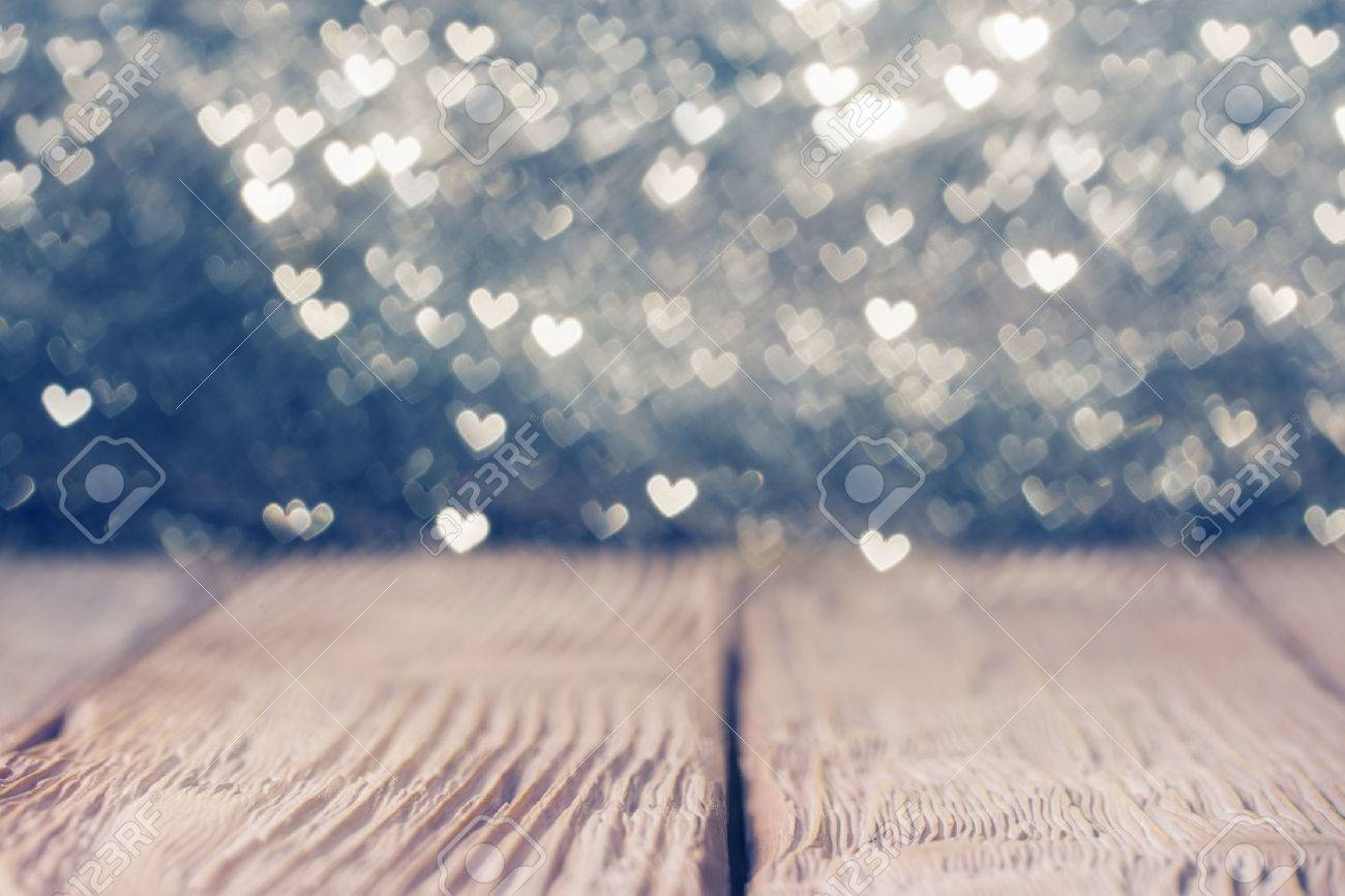 Vintage Wooden Deck Over Heart Shaped Defocused Lights Shallow
