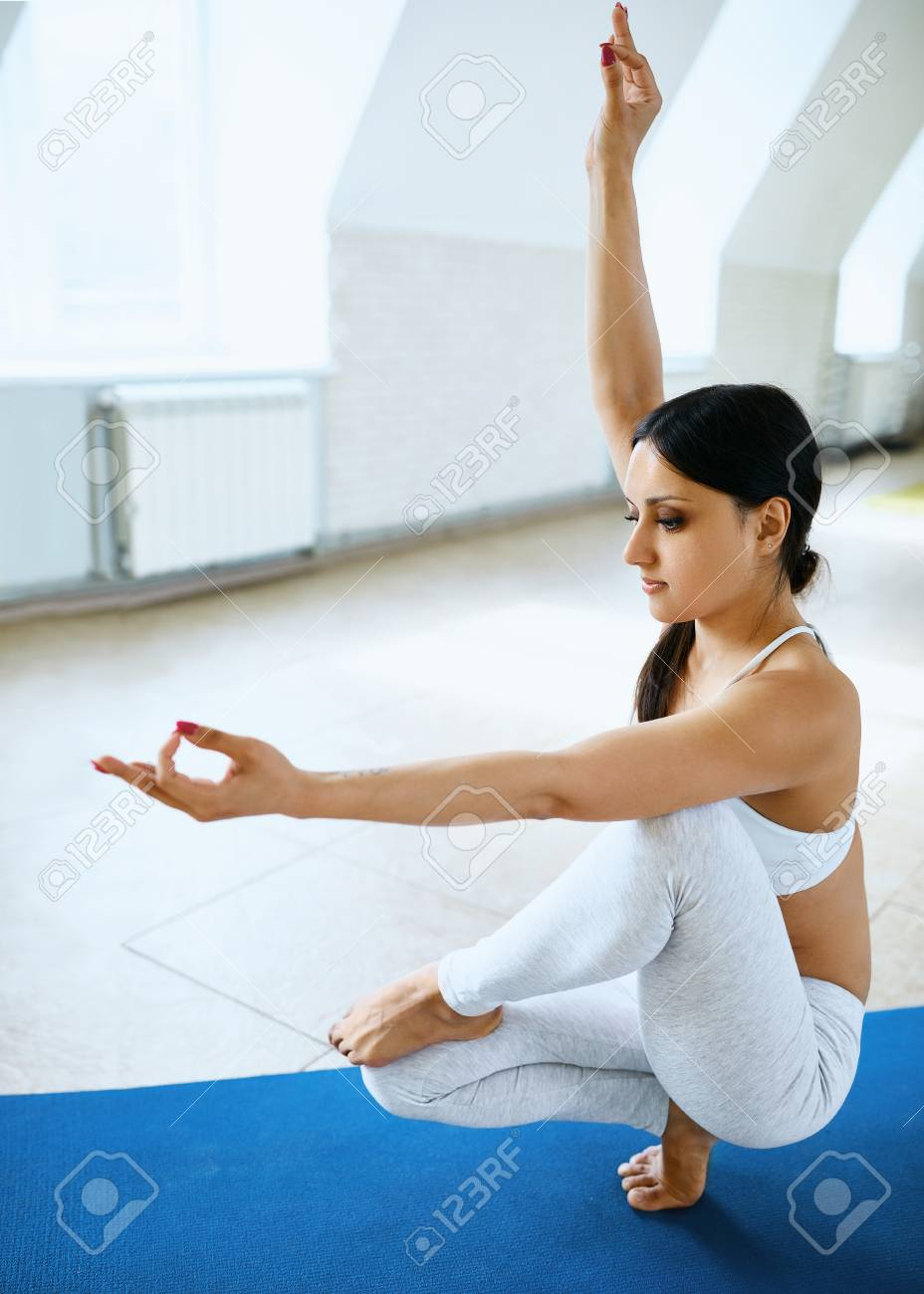 Sporty Attractive Woman In White Sportswear Doing Beautiful Yoga Stock Photo Picture And Royalty Free Image Image 121186250