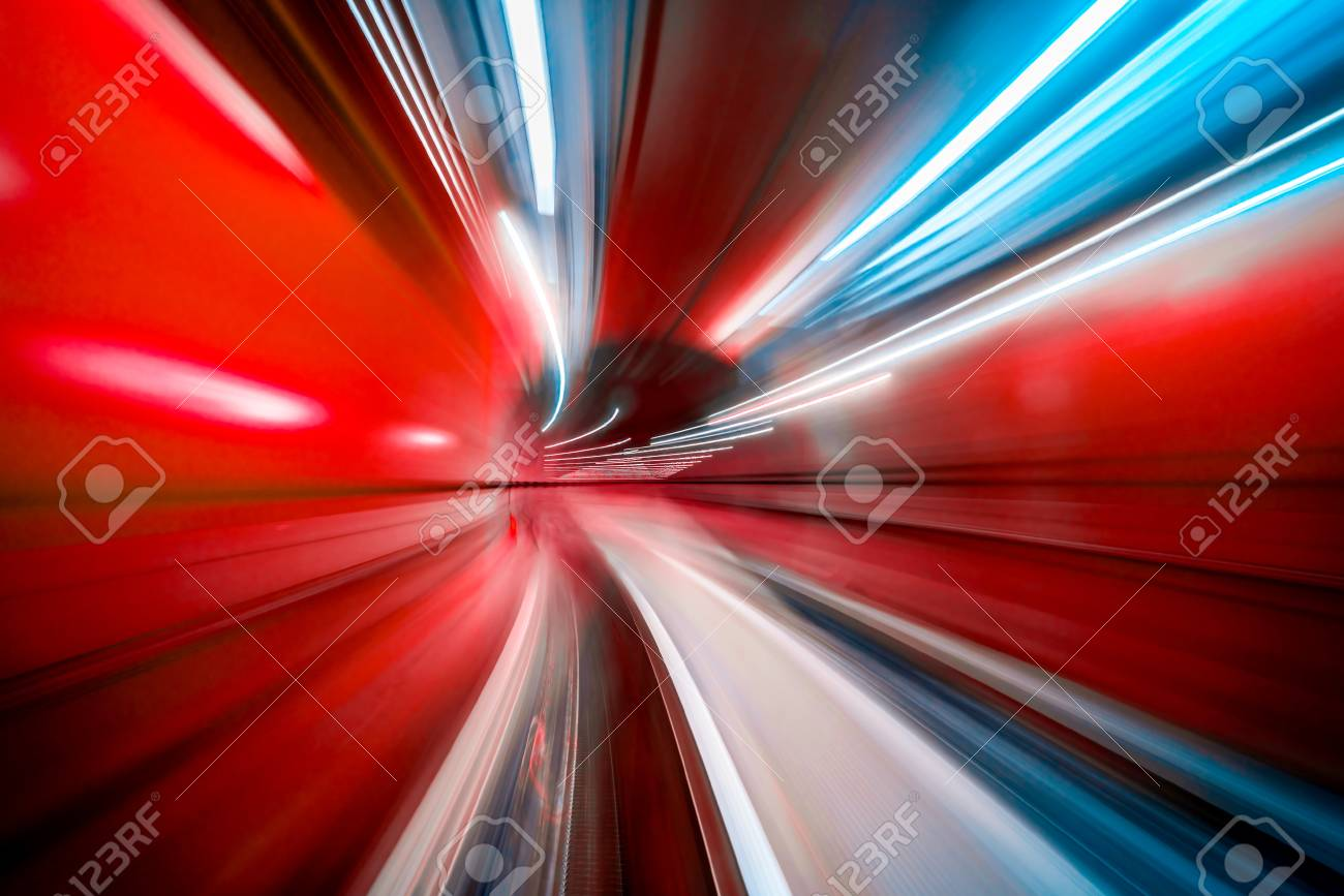 Abstract colorful concentric light trail accelerating through a tunnel. - 124957073