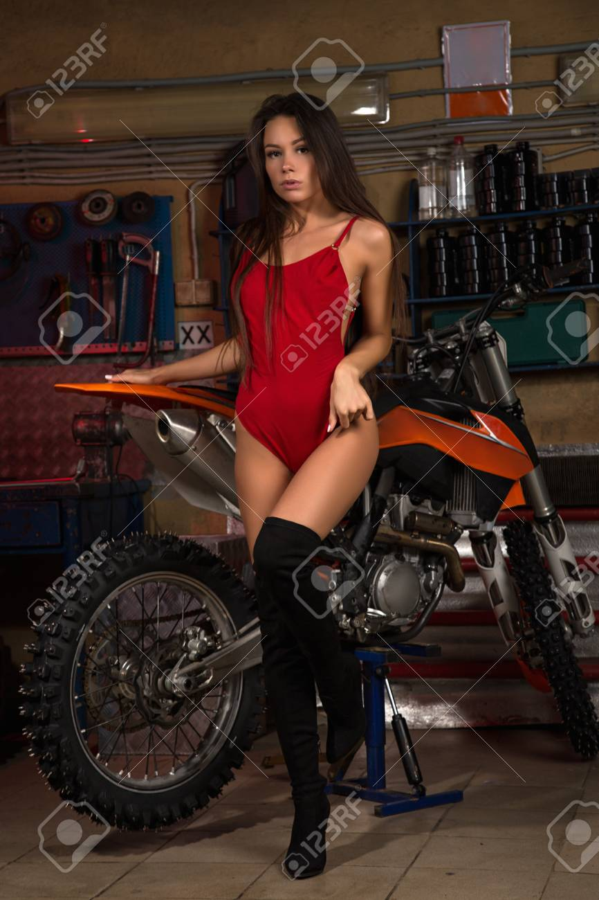 Biker chick pics Sexy Biker Chick Posing With Motorcycle In Garage Stock Photo Picture And Royalty Free Image Image 97282206