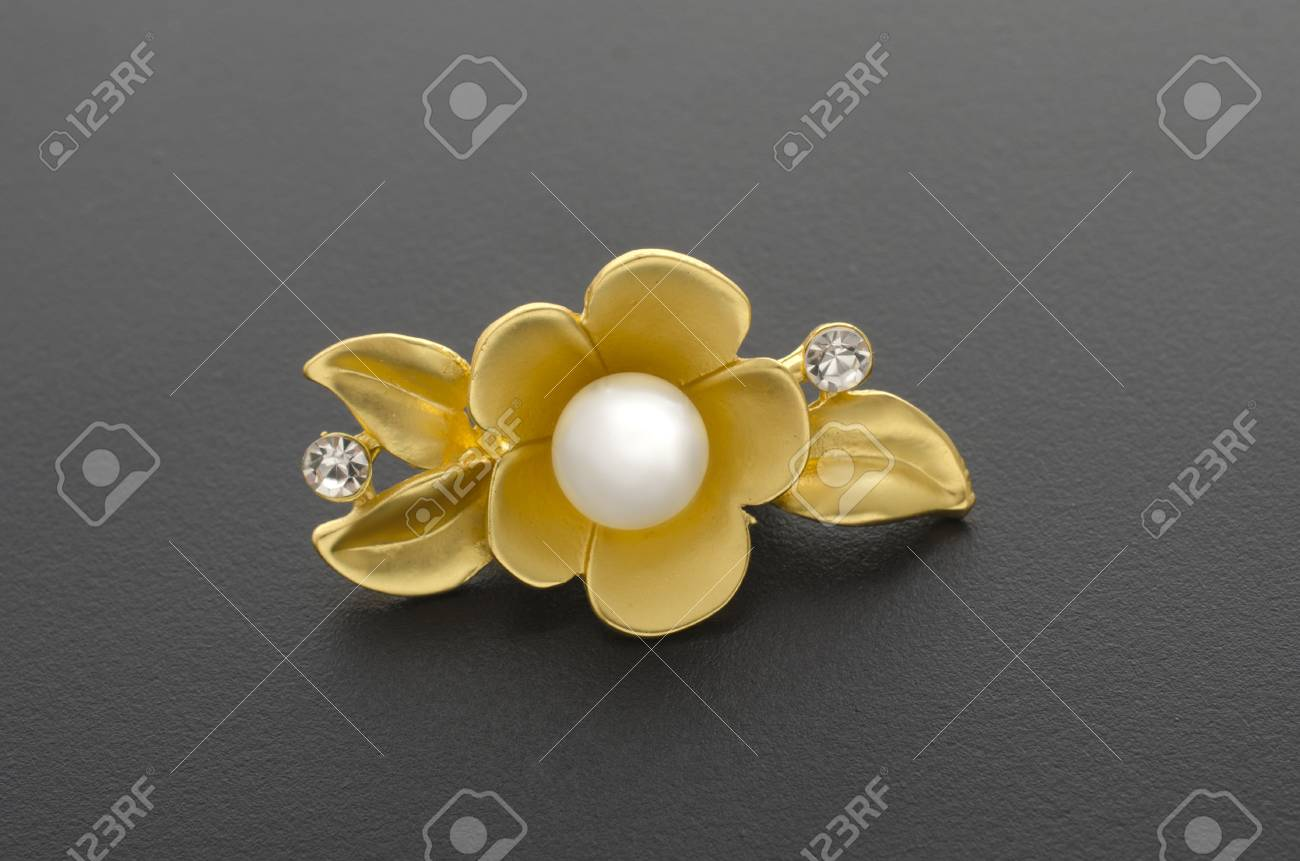 c655a6cee9c76 gold brooch flower with pearl isolated on black