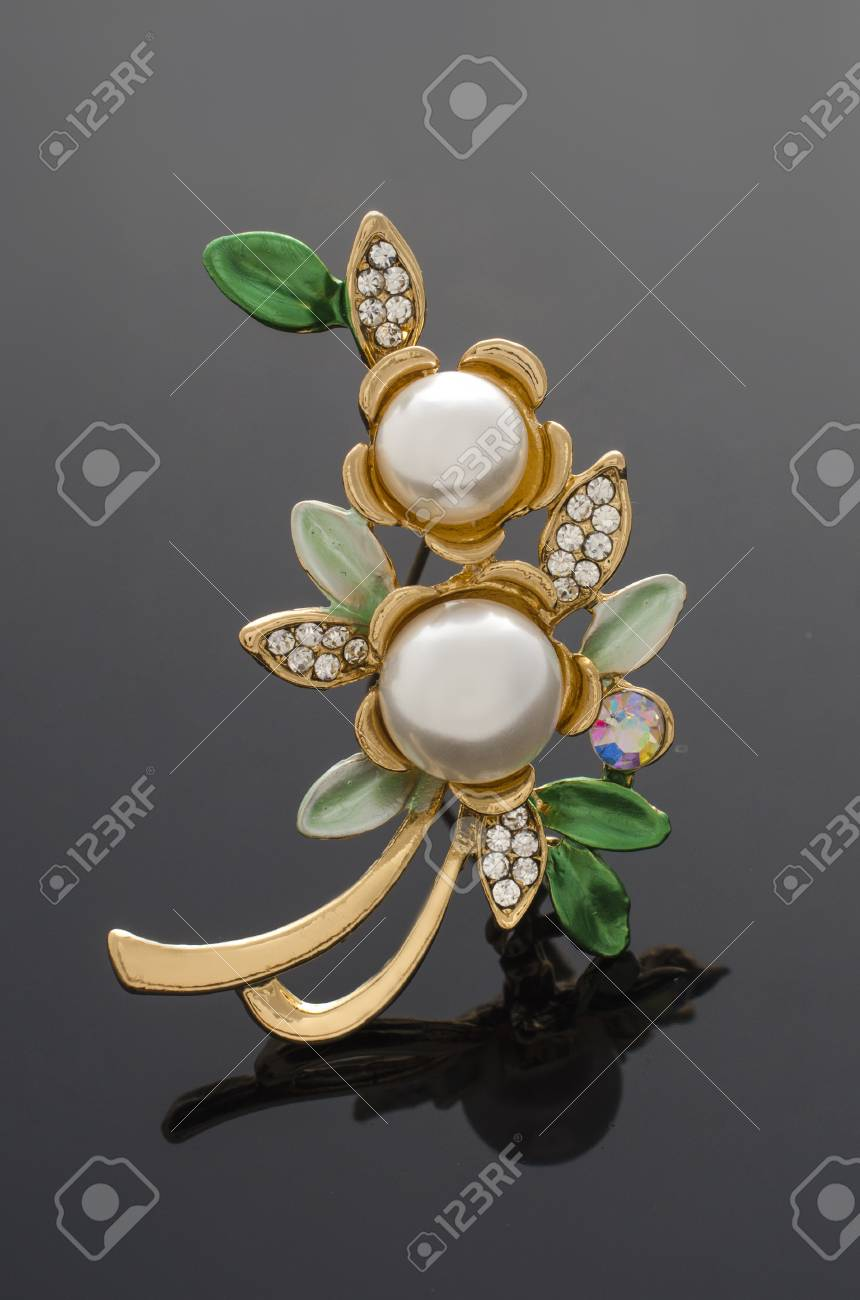 24f7f126fd1b3 golden brooch flower with pearls isolated on black. brooch flower