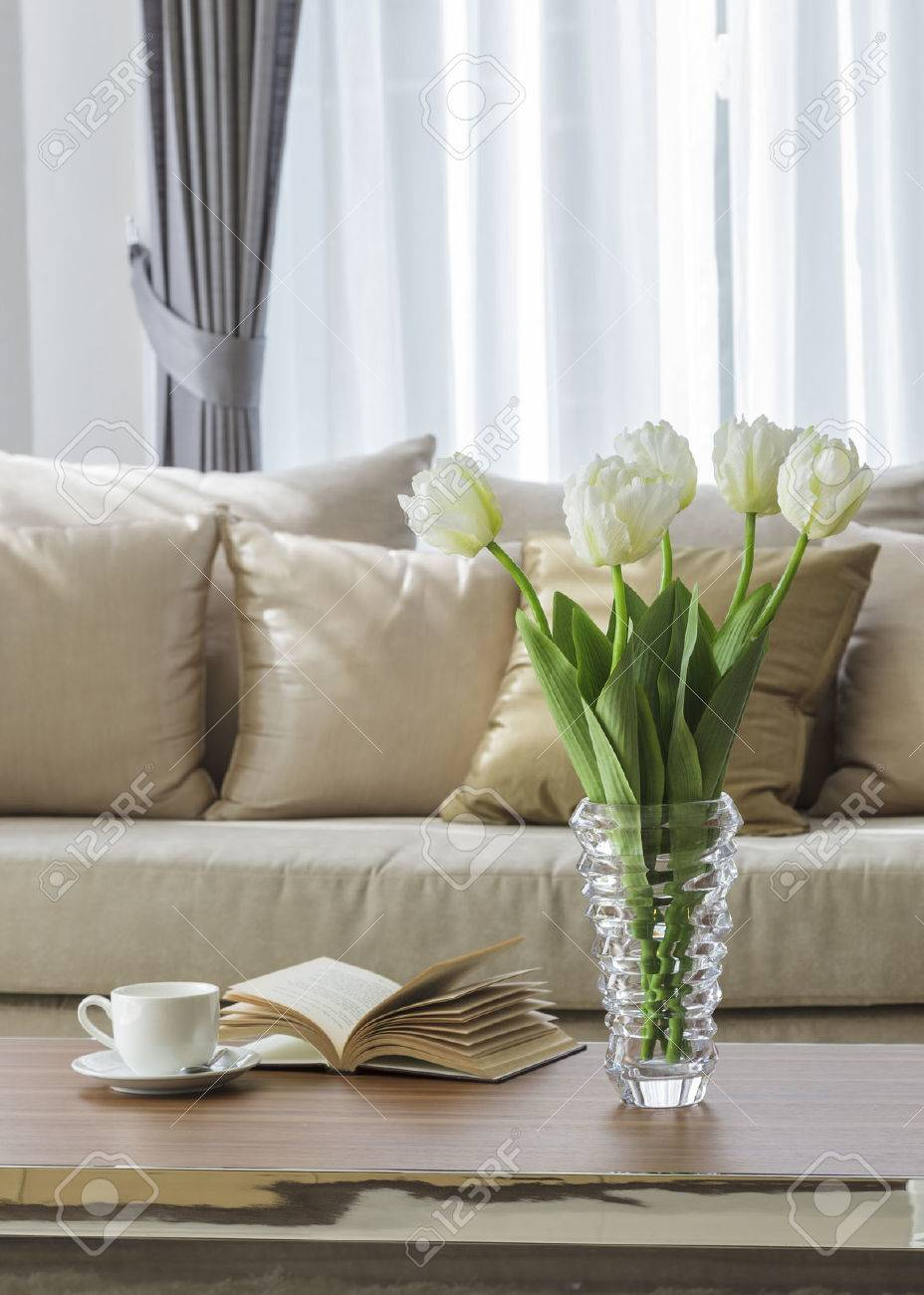 living room sofa with flower coffee and book on table stock photo living room sofa with flower coffee and book on table stock photo 35284709
