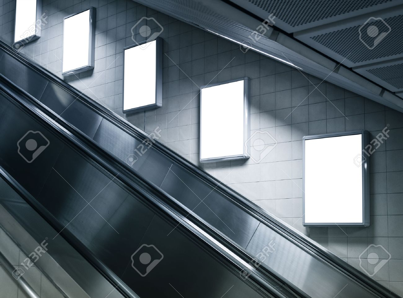 Mock Up Poster Ads At Escalator Side In Subway Station Stock Photo