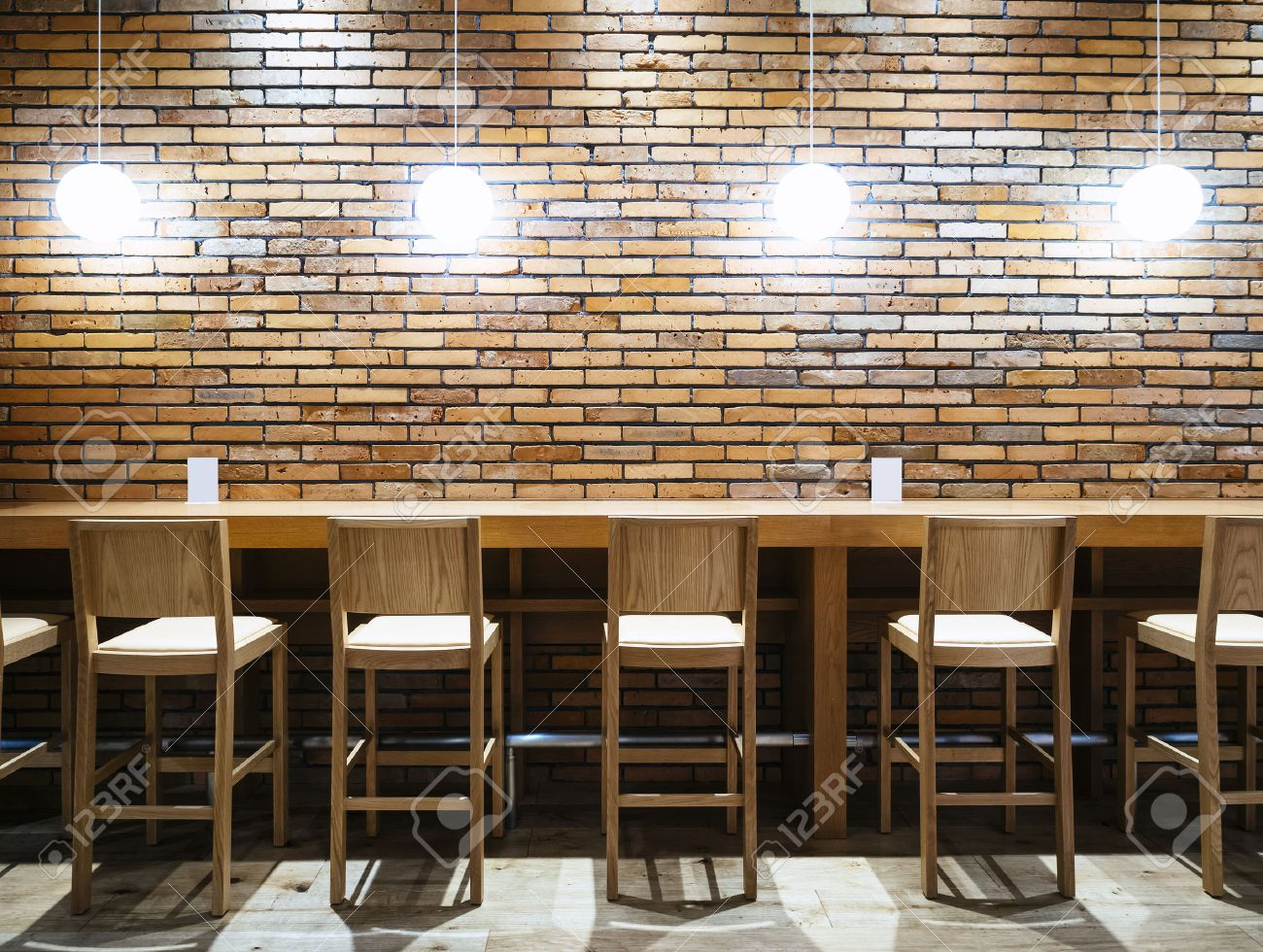 Table Counter Bar With Chairs And Lights Brick Wall Background Stock Photo Picture And Royalty Free Image Image 50986789