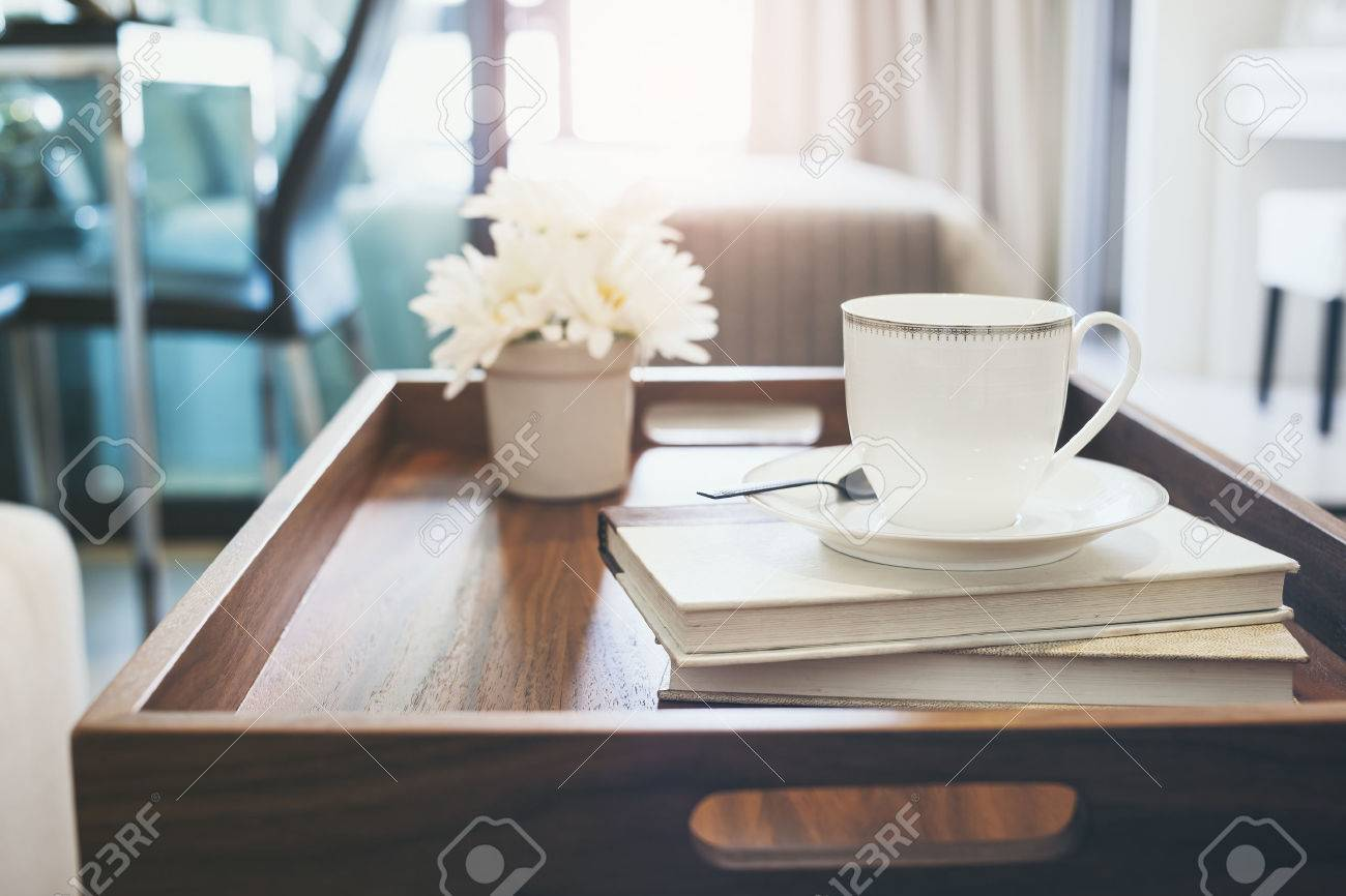 home interior with coffee cup book white flower on table wooden home interior with coffee cup book white flower on table wooden tray hipster lifestyle background stock