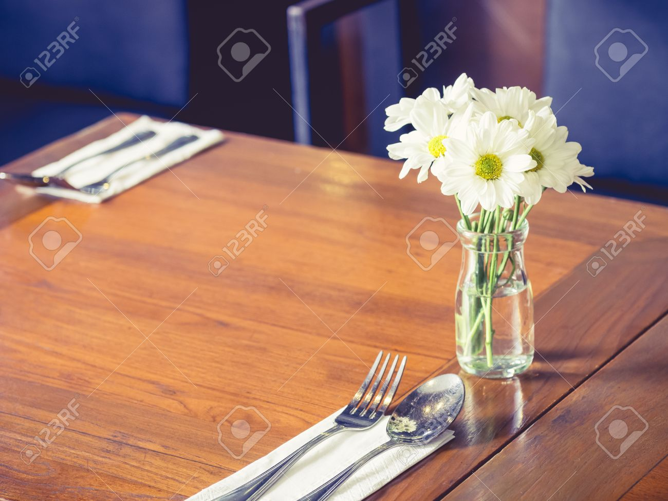 cafe restaurant table with white flower decoration stock photo