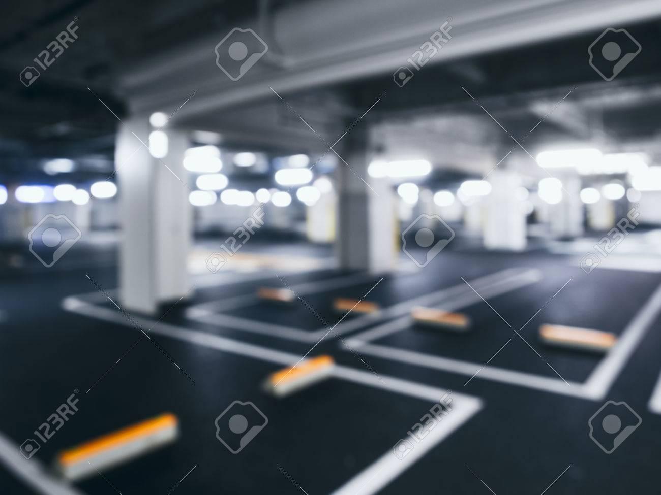 Blurred car park indoor Basement with Neon Lighting - 58149308