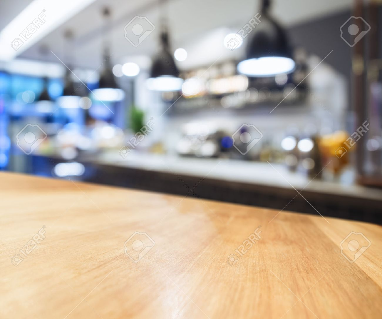 Restaurant Kitchen Background Table Top Counter With Blurred Kitchen Background Stock Photo