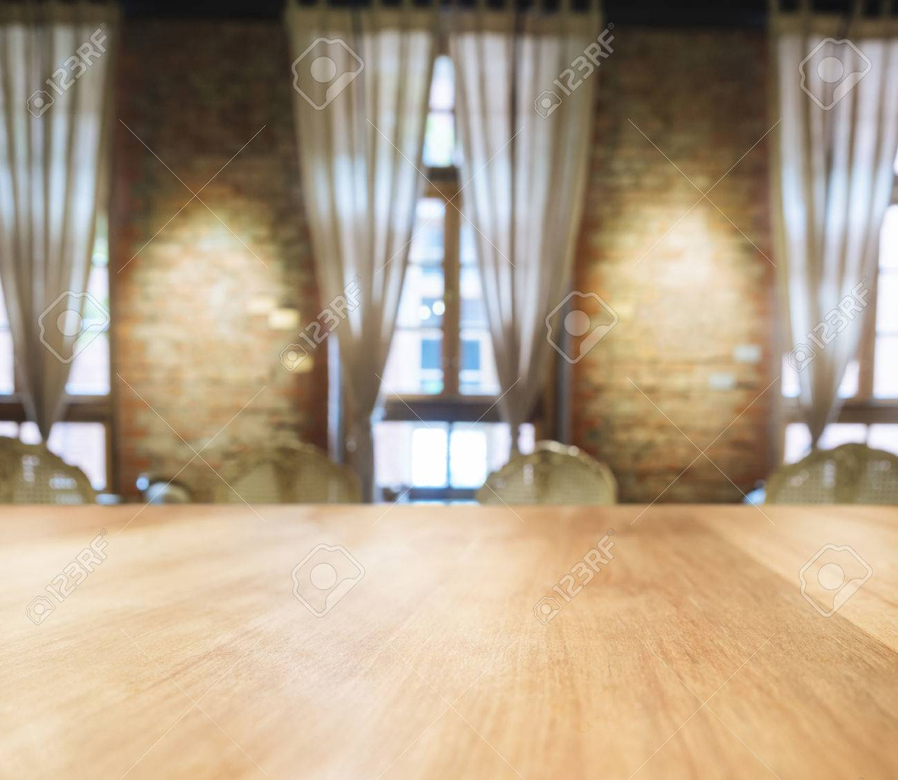 Stock Photo   Table Top With Blurred Dining Room Interior Background