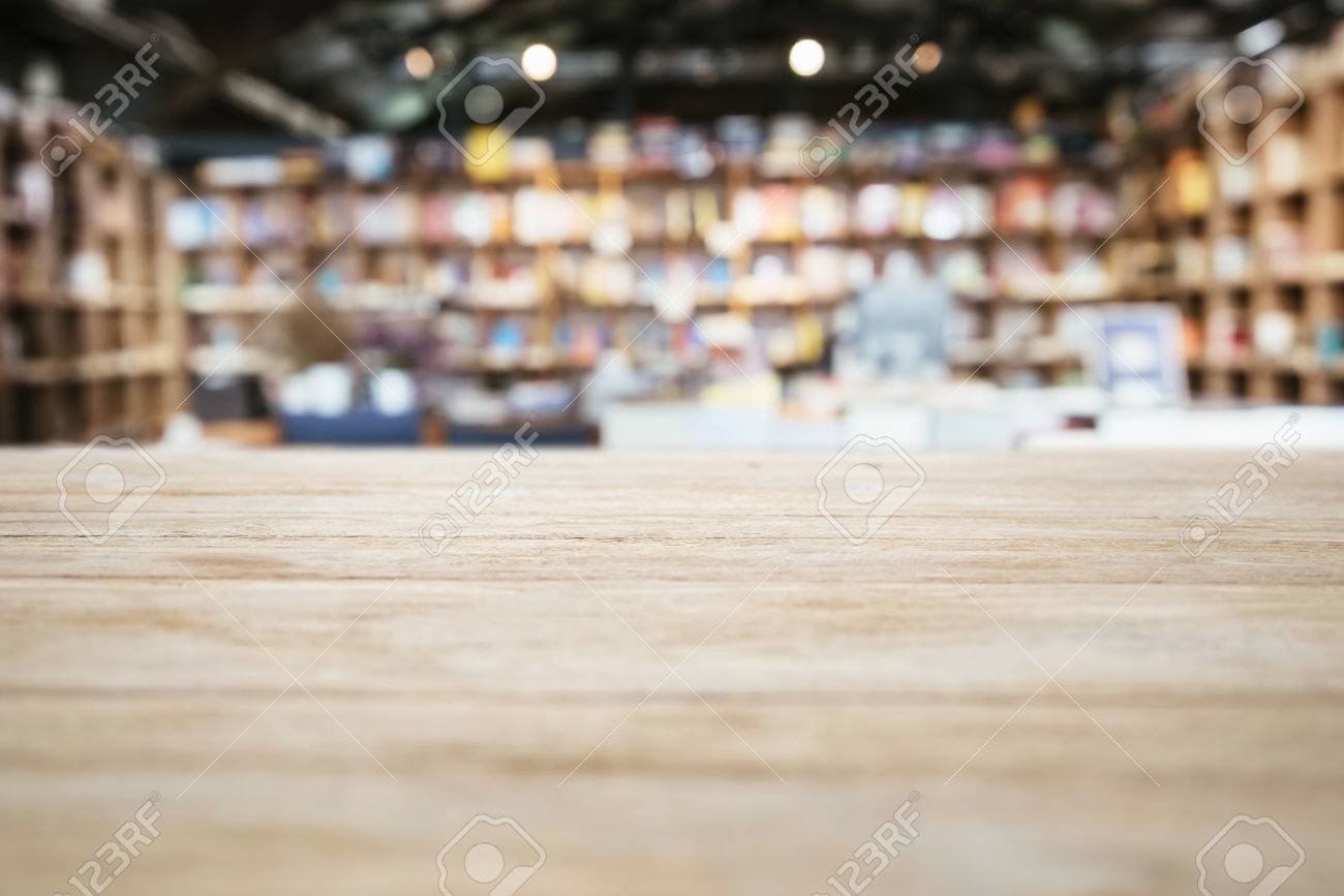 Stock Photo   Table Top Counter With Blurred Bookshelf Bookstore Background