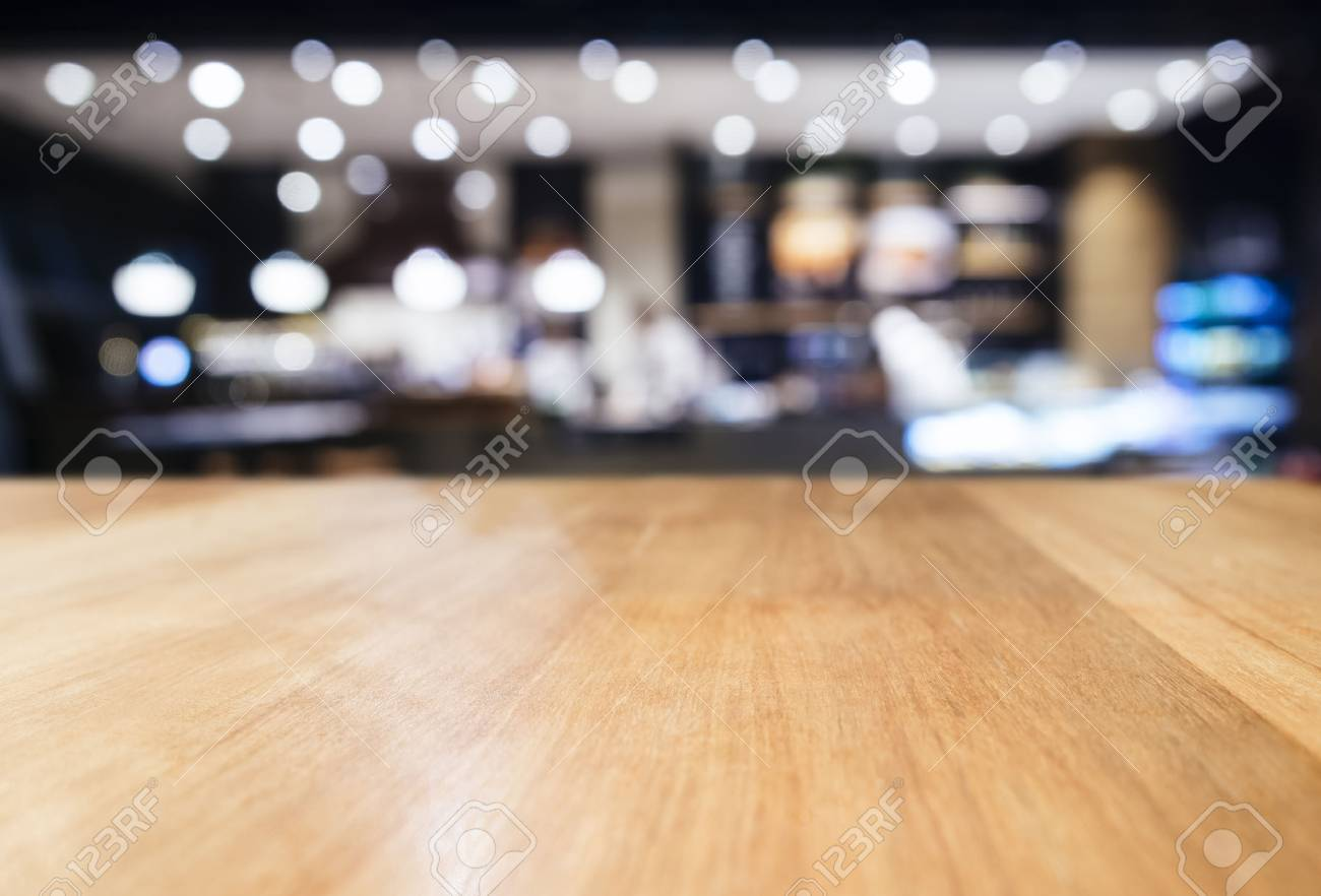 restaurant table top lighting. Stock Photo - Table Top Counter With Blurred Bar Restaurant Lighting Decoration Background L