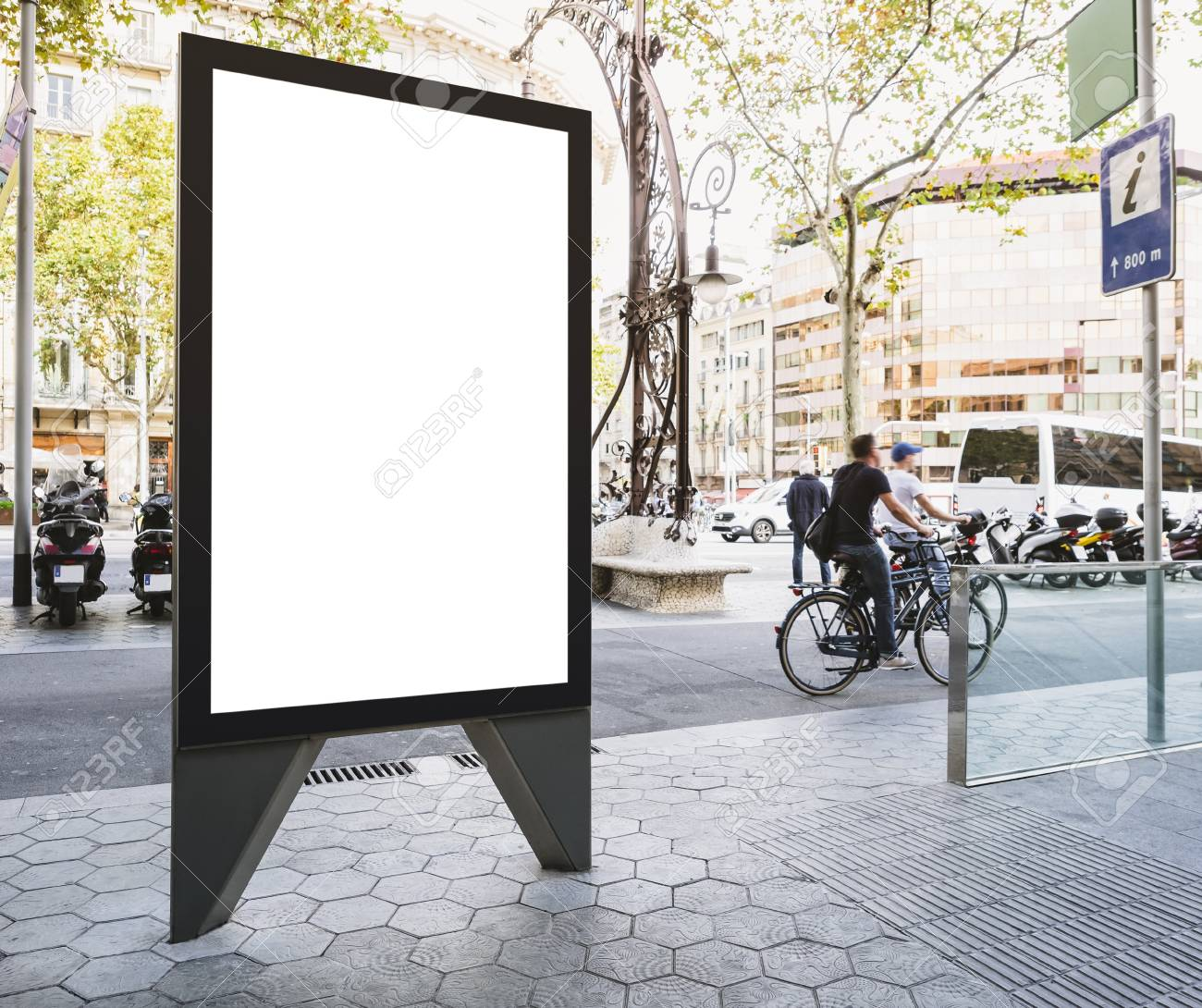 Mock up Banner stand Media outdoor Information Sign with people riding on City street - 115334185