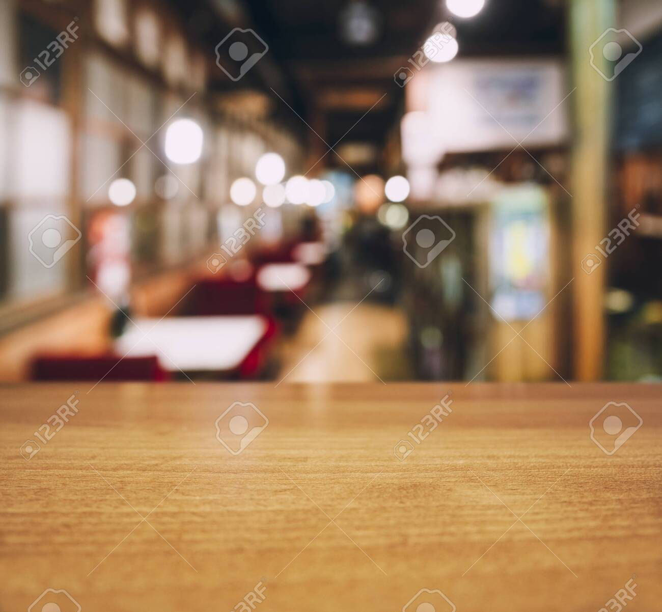 Table top wooden counter Blur Cafe restaurant seats interior background - 147726573