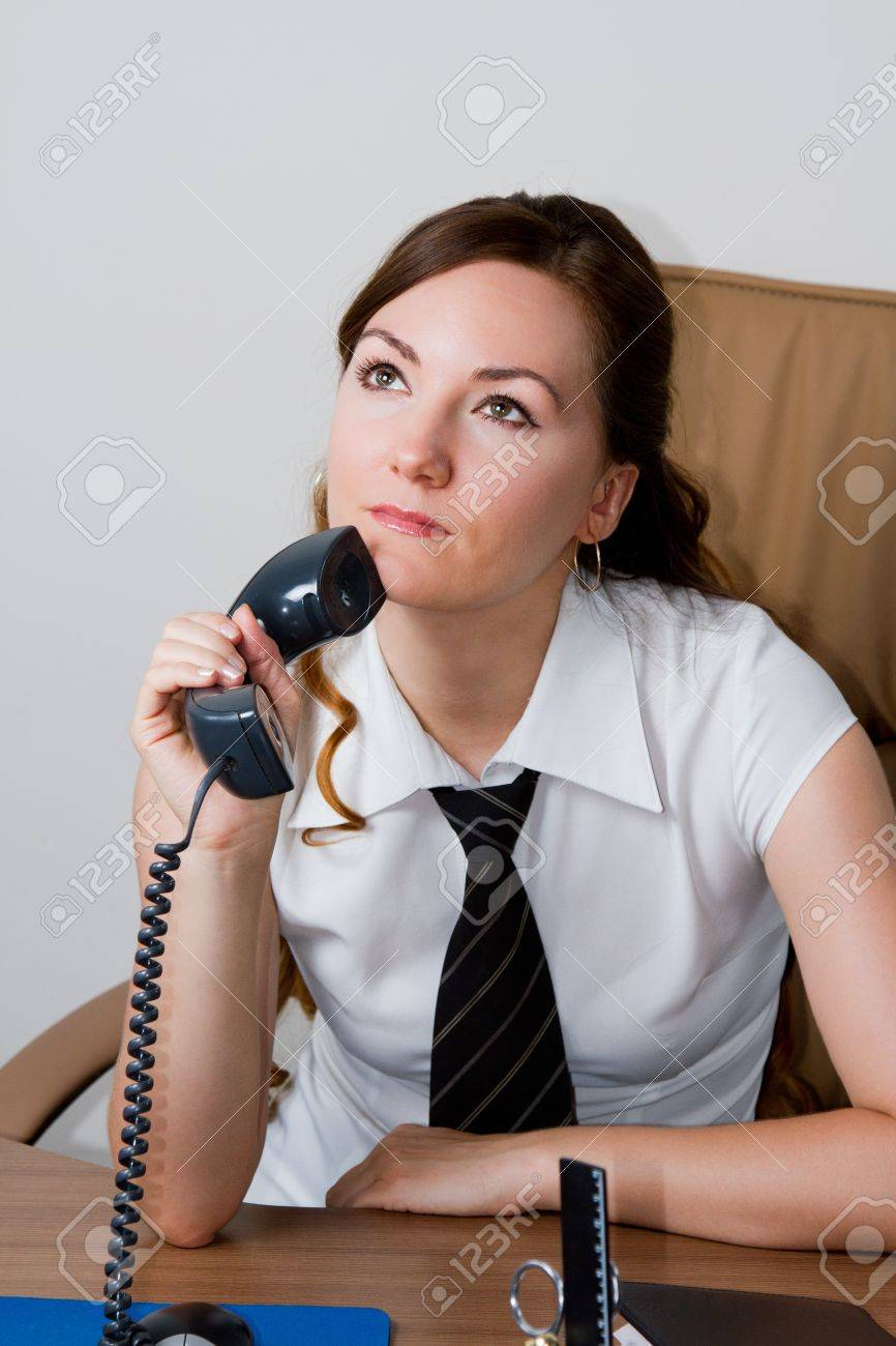 pensive secretary with a phone Stock Photo - 10042581