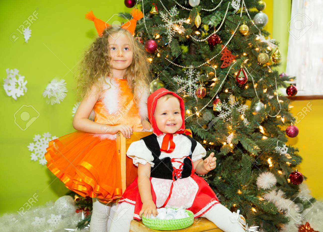 Portrait Of Children Girls In A Suit Squirrels Around A Christmas Stock Photo Picture And Royalty Free Image Image 70847449