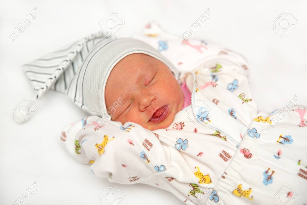 A cute newborn baby girl sleeping sweet little baby portrait use the photo to