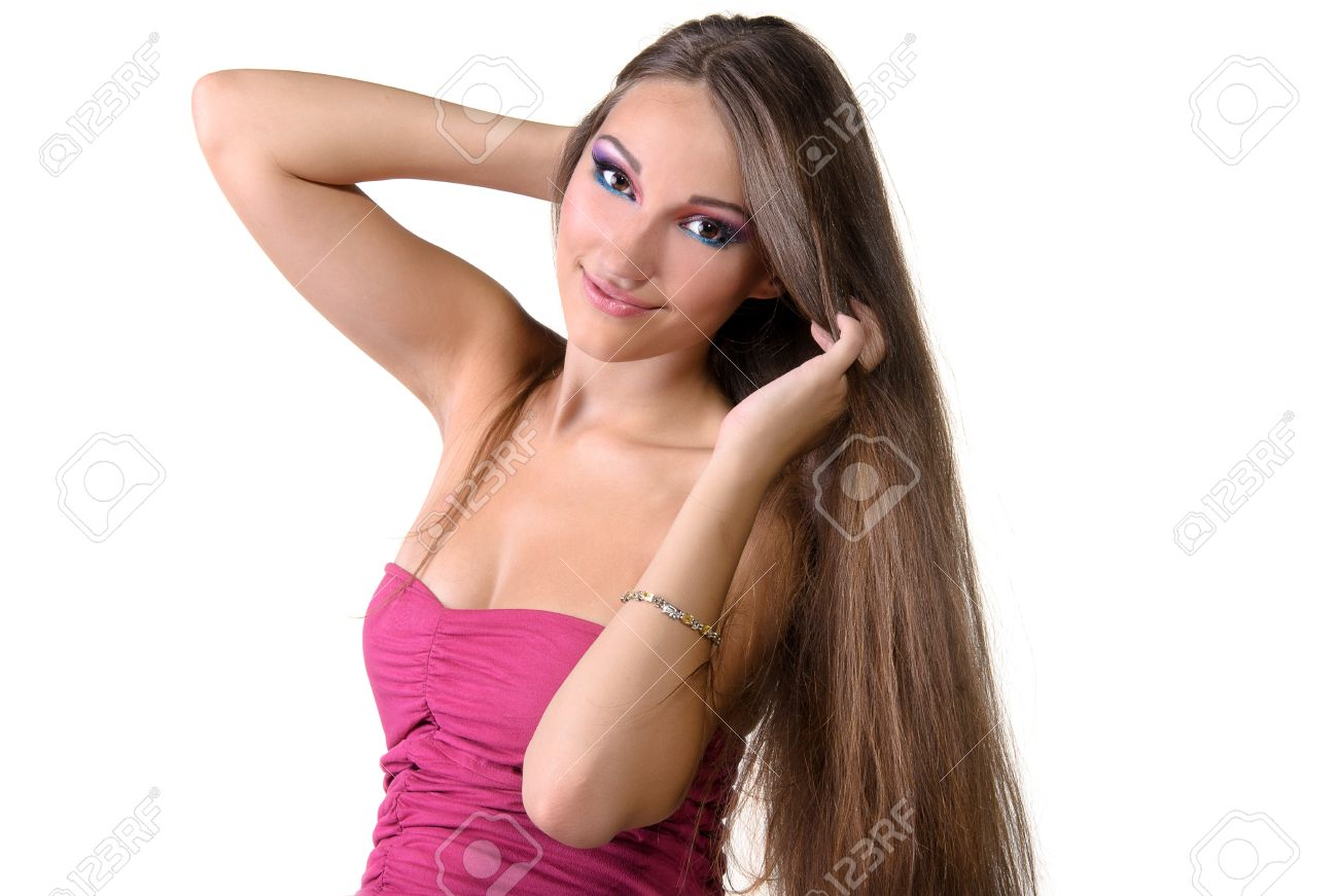 Beautiful Professionally Madeup Smiling Sexy Girl With Long Brown Hair Wearing Pink Dress Stock Photo