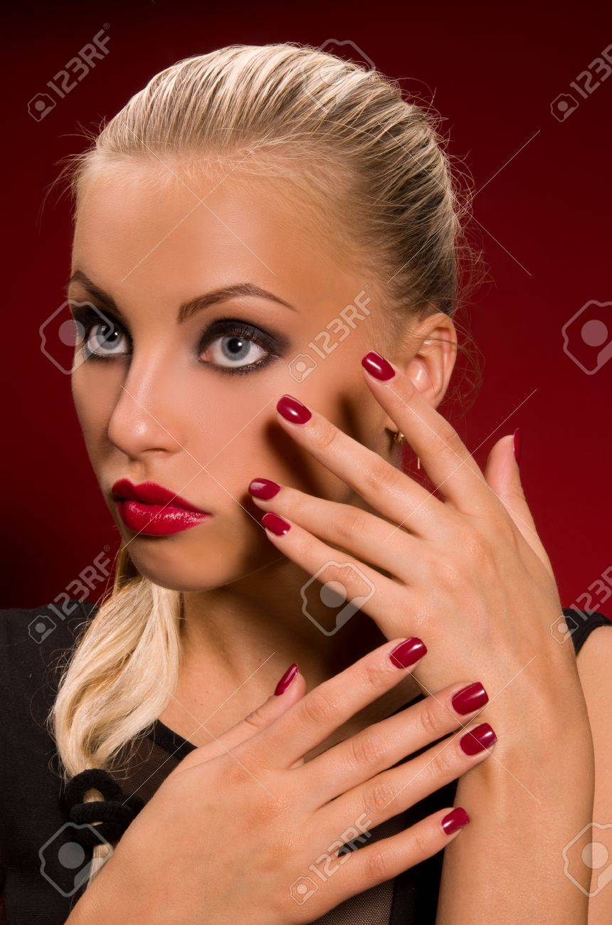 sexy girl with aggressive makeup on a dark red background Stock Photo - 16512332
