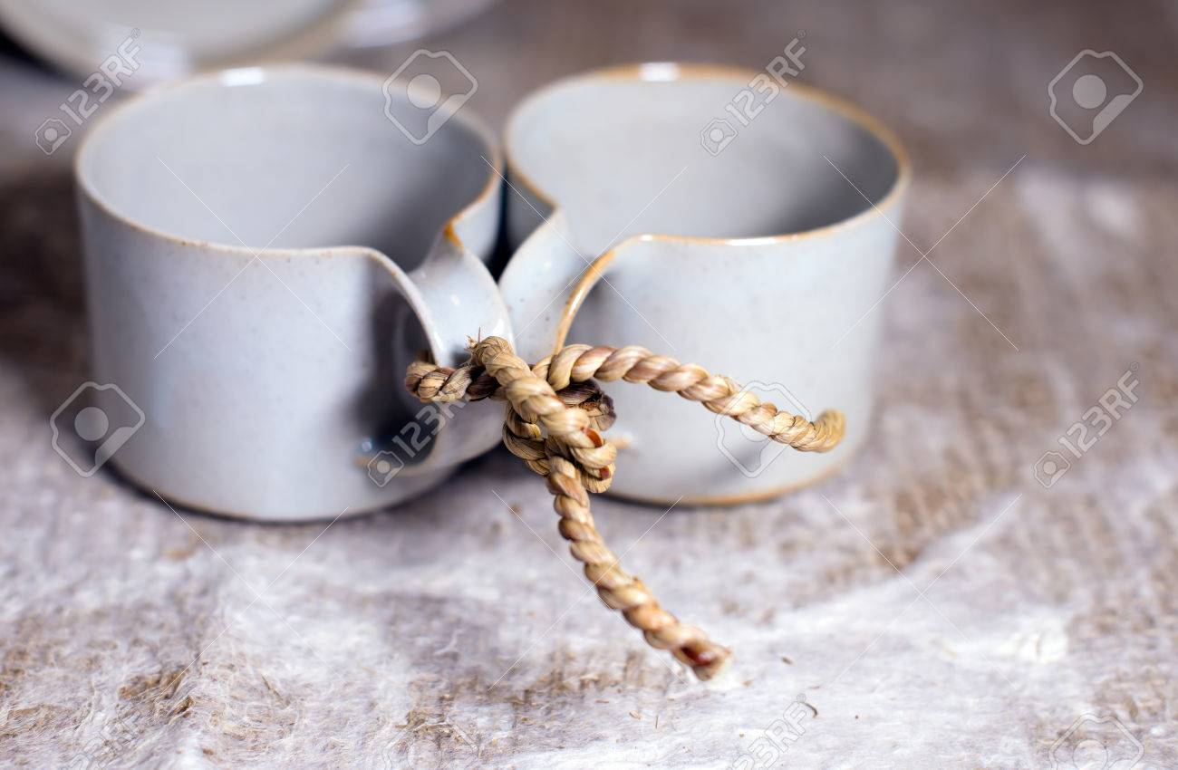 Two Mod Cups Tied By Rope Together As A Symbol Of Loyalty And