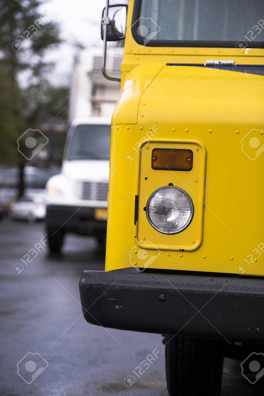 A Part Of Old Style Bright Yellow Little Buggy Truck With A Covered ...