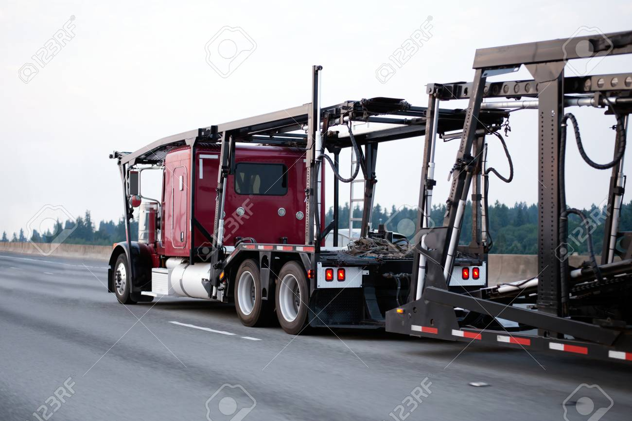 A Large Red Powerful Big Rig Car Hauler Semi Truck With An Empty ...
