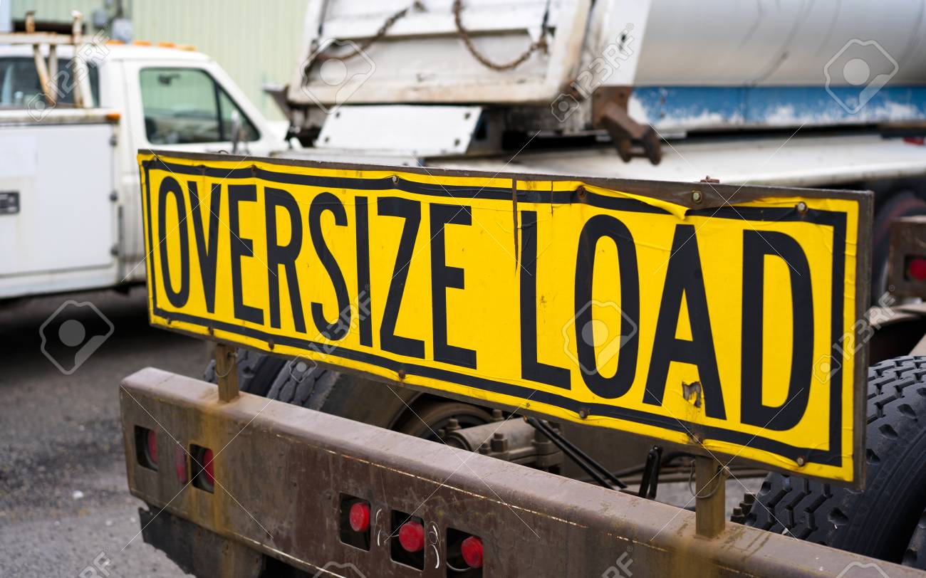 Wide Load Sign >> Black On Yellow Oversize Load Sign Installed On The Back Of Big