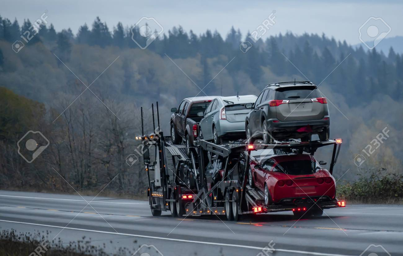 Car transportation by big rig semi truck allows all dealerships to ensure uninterrupted sale of new and used cars ensuring consumer demand in any state of America. Trucks carry out the main freight - 113942075