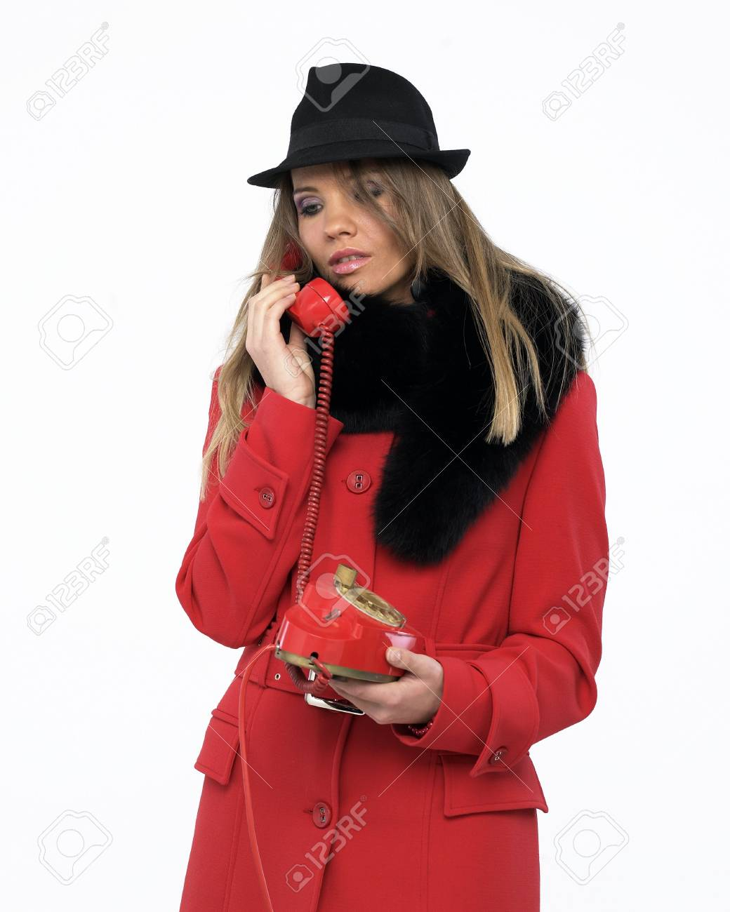 Young woman on an old red phone Stock Photo - 4171130