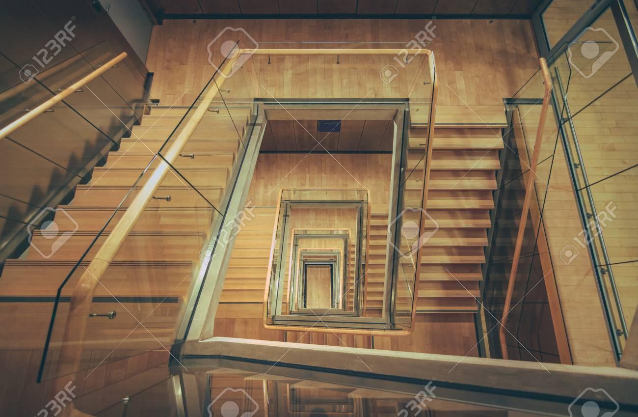Spiral Staircase From Above With Parquet Floor. Square Shaped Stairs Going  Downwards Creating Layers From