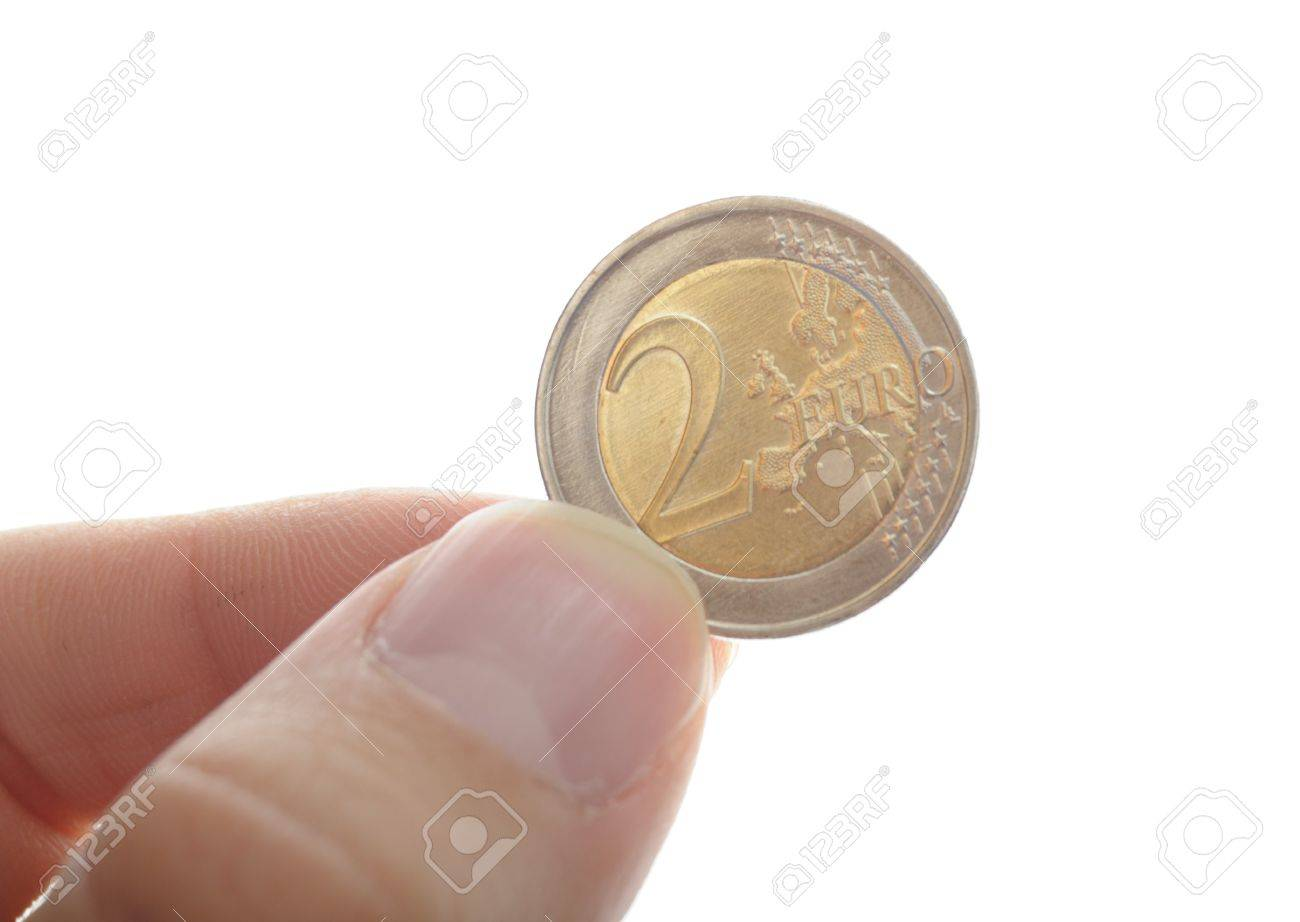 human hand holding an euro coin, isolated on white background Stock Photo - 7180054