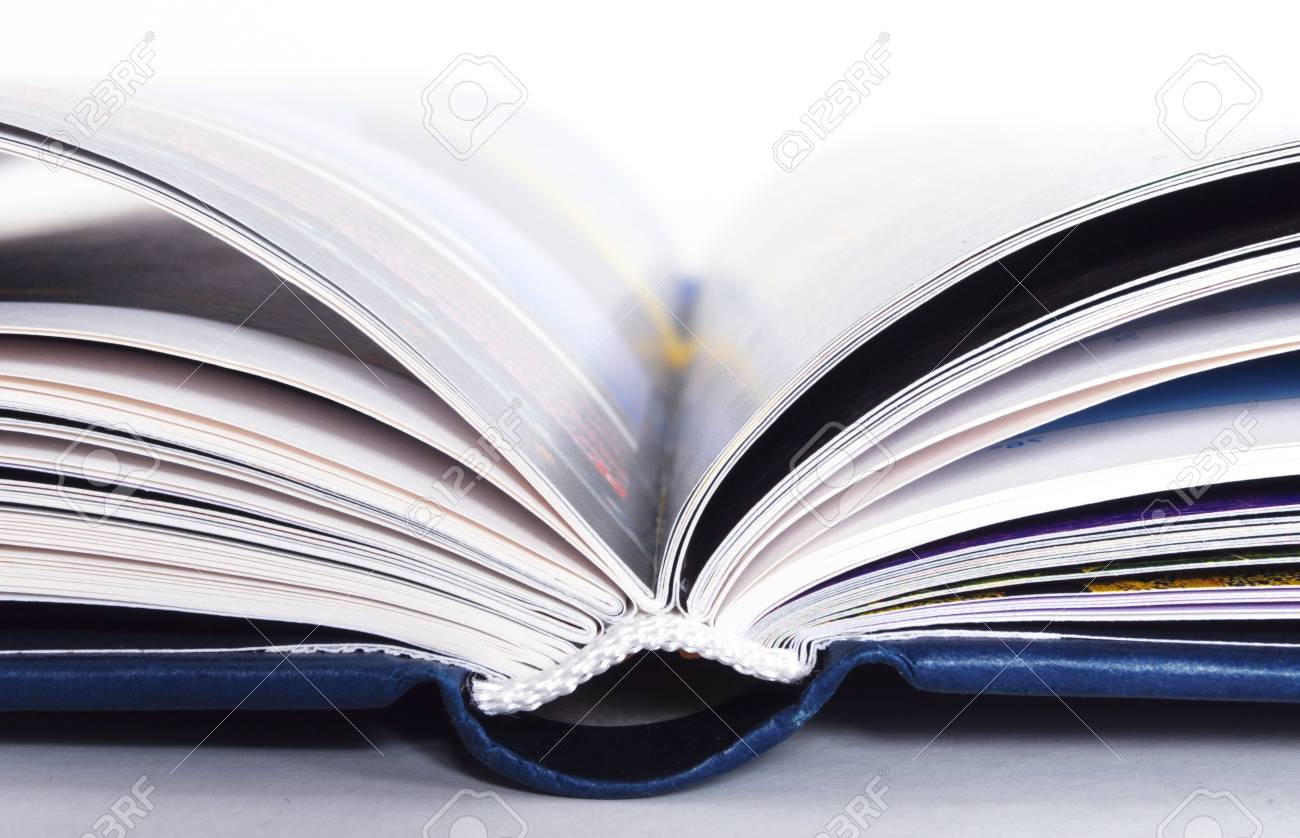 detail of a blue open book isolated on white background Stock Photo - 8825931