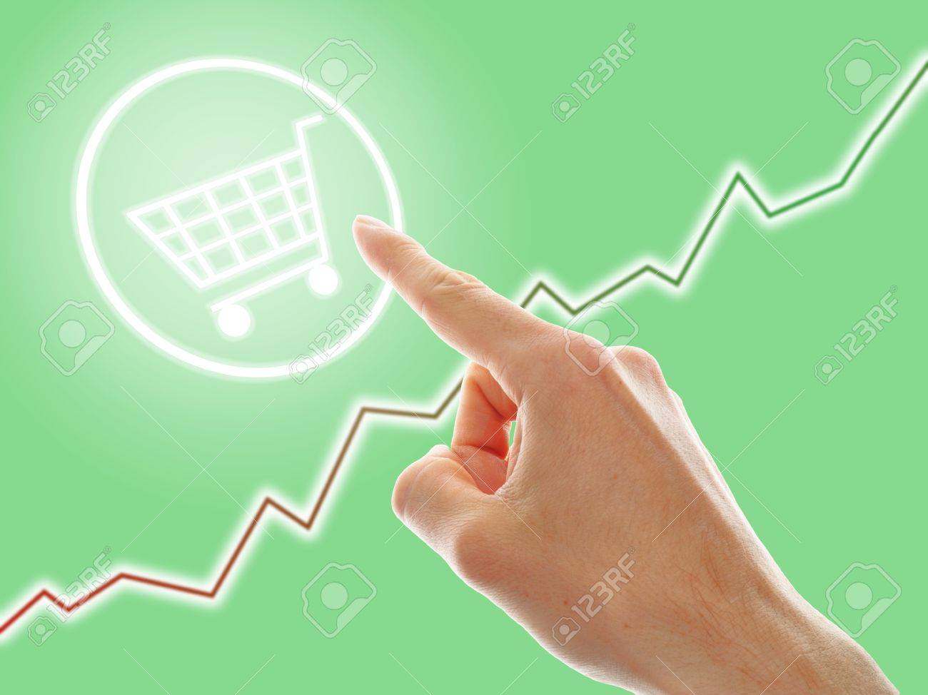 concept of growing e-commerce. shopping cart and graph Stock Photo - 14180662