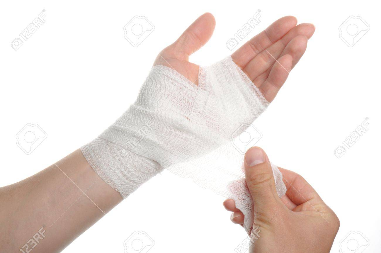 white medicine bandage on injury hand on white background stock