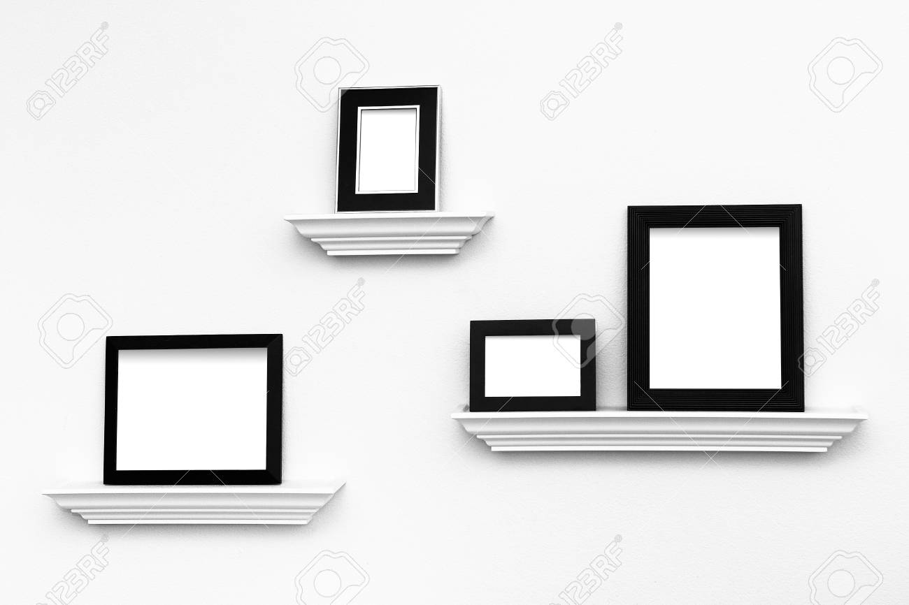 Multiple Black And White Picture Frames On Picture Ledges Attached ...