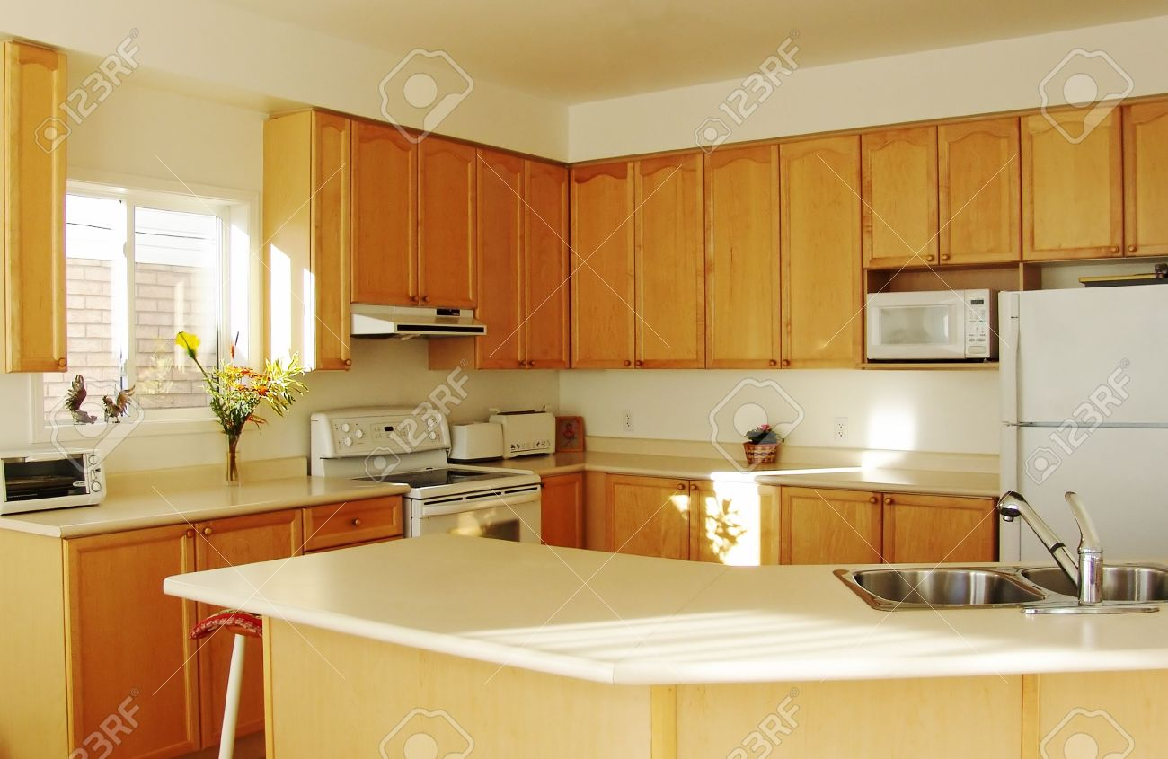 Modern House Interior New Kitchen With Maple Cabinets Stock Photo