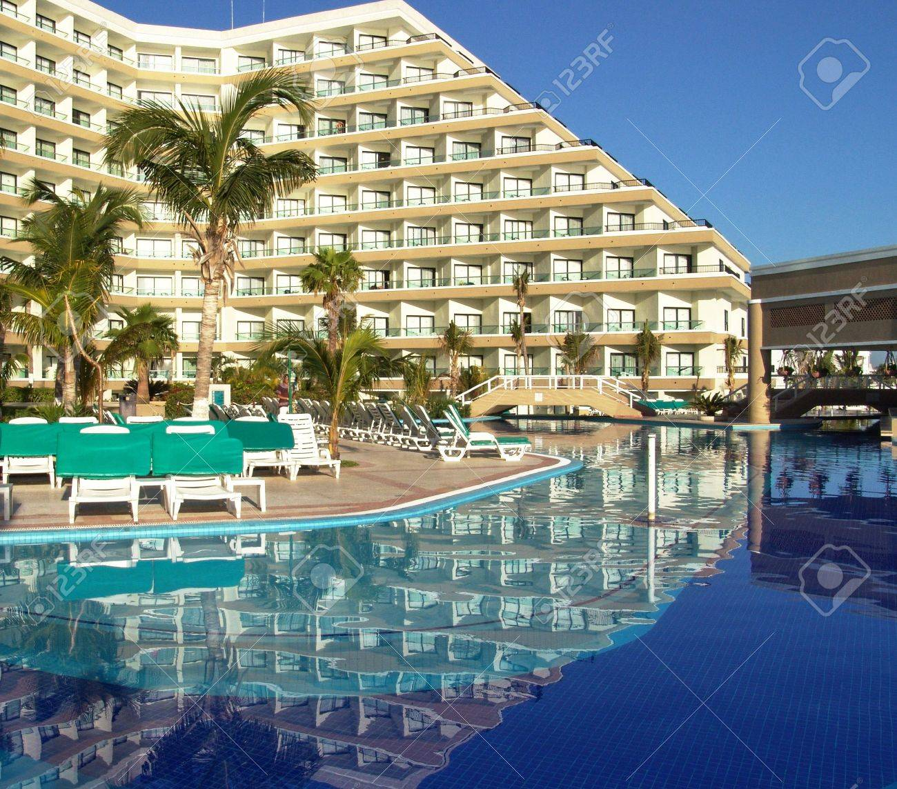 luxury resort hotel with swimming pool, cancun, mexico. stock