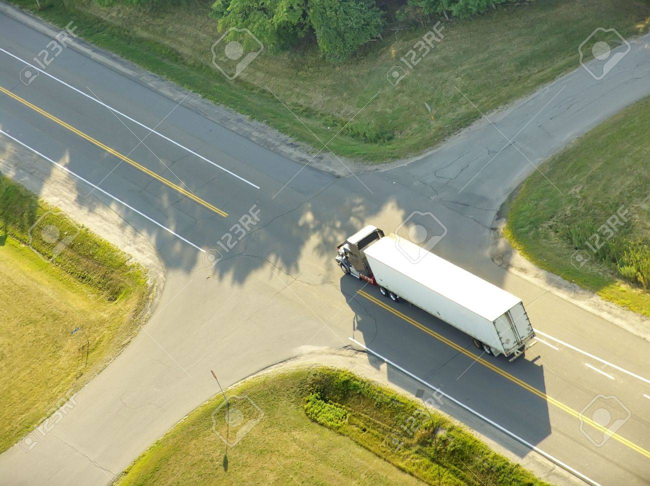 Aerial view of a truck approaching a roads intersection. - 2899182