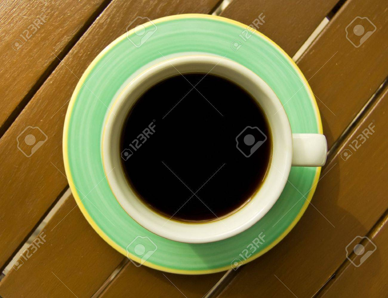 Coffee cup. Directly above om wood planked table. - 5426162