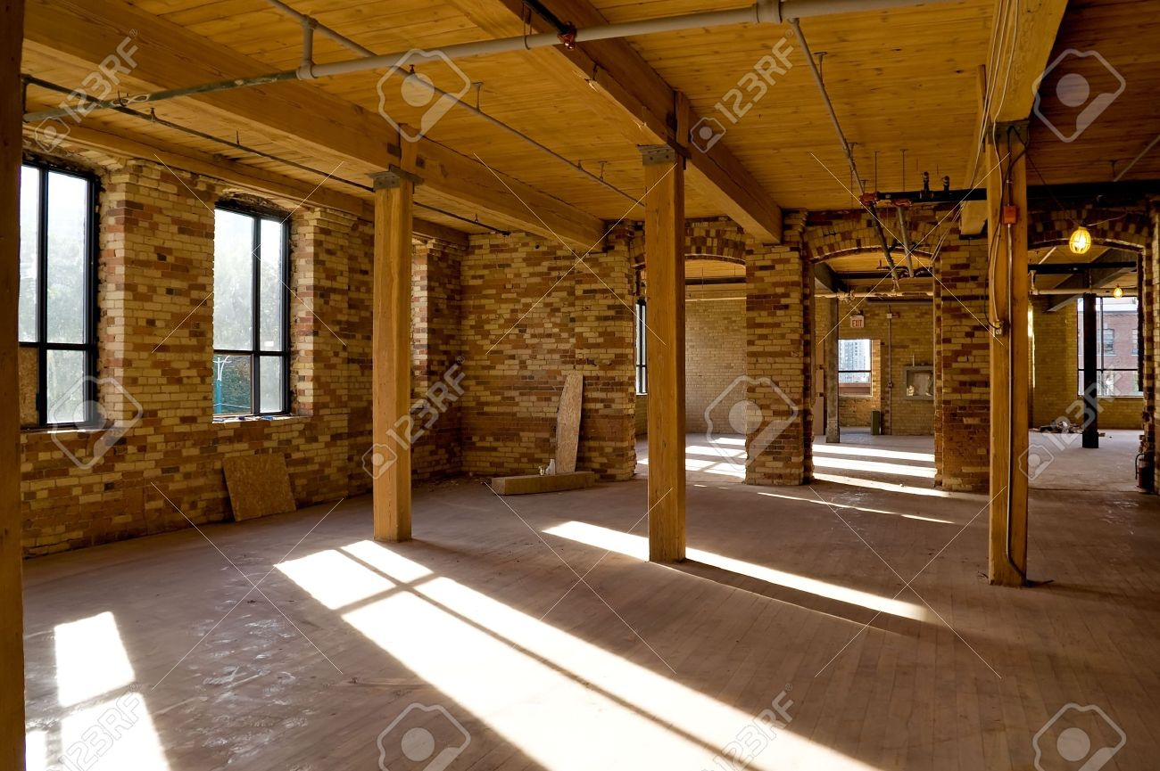Old brick building is under reconstruction for modern office spaces. - 5426303