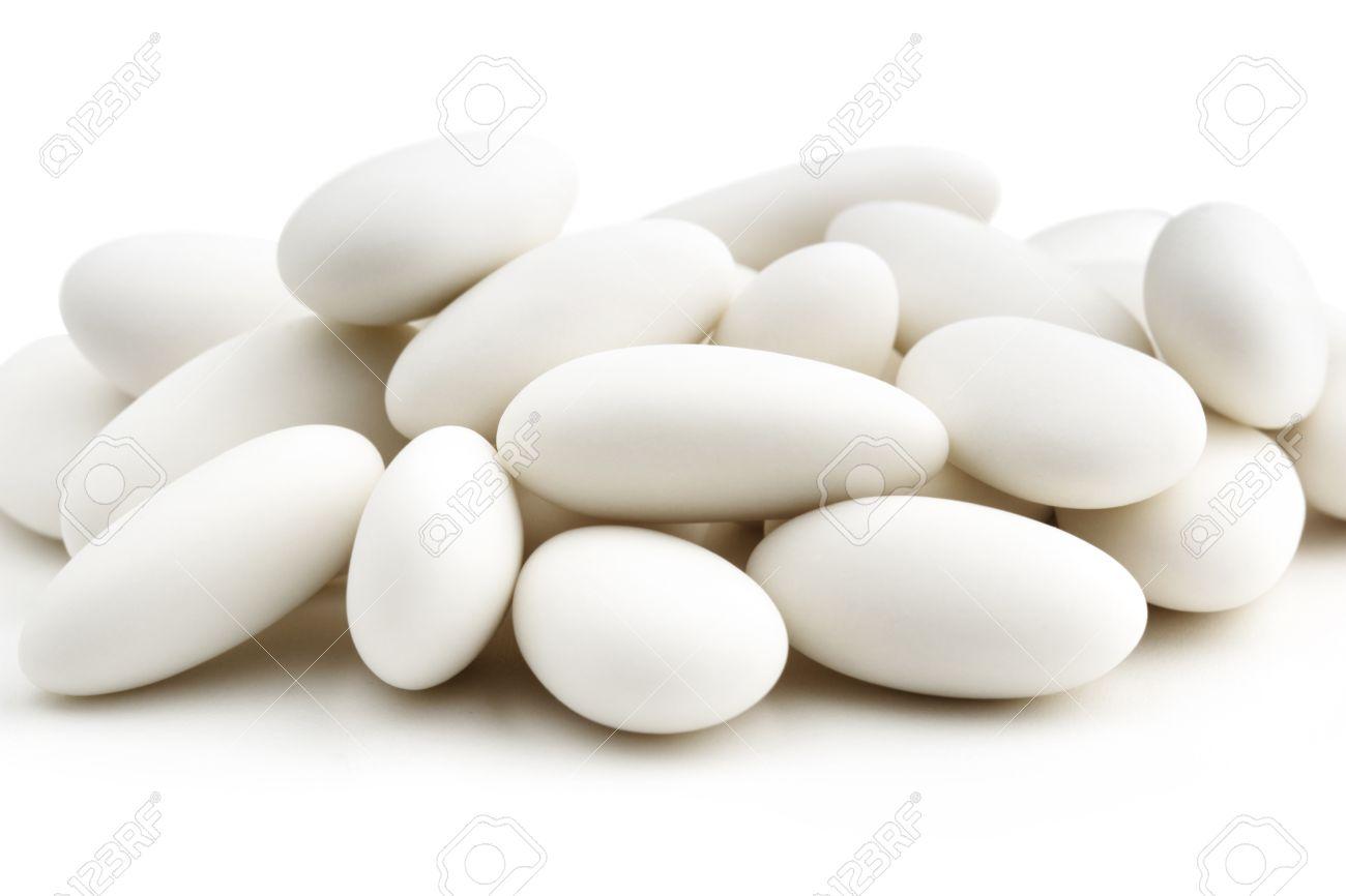 heap of  white sugared almonds on white background Stock Photo - 24189193