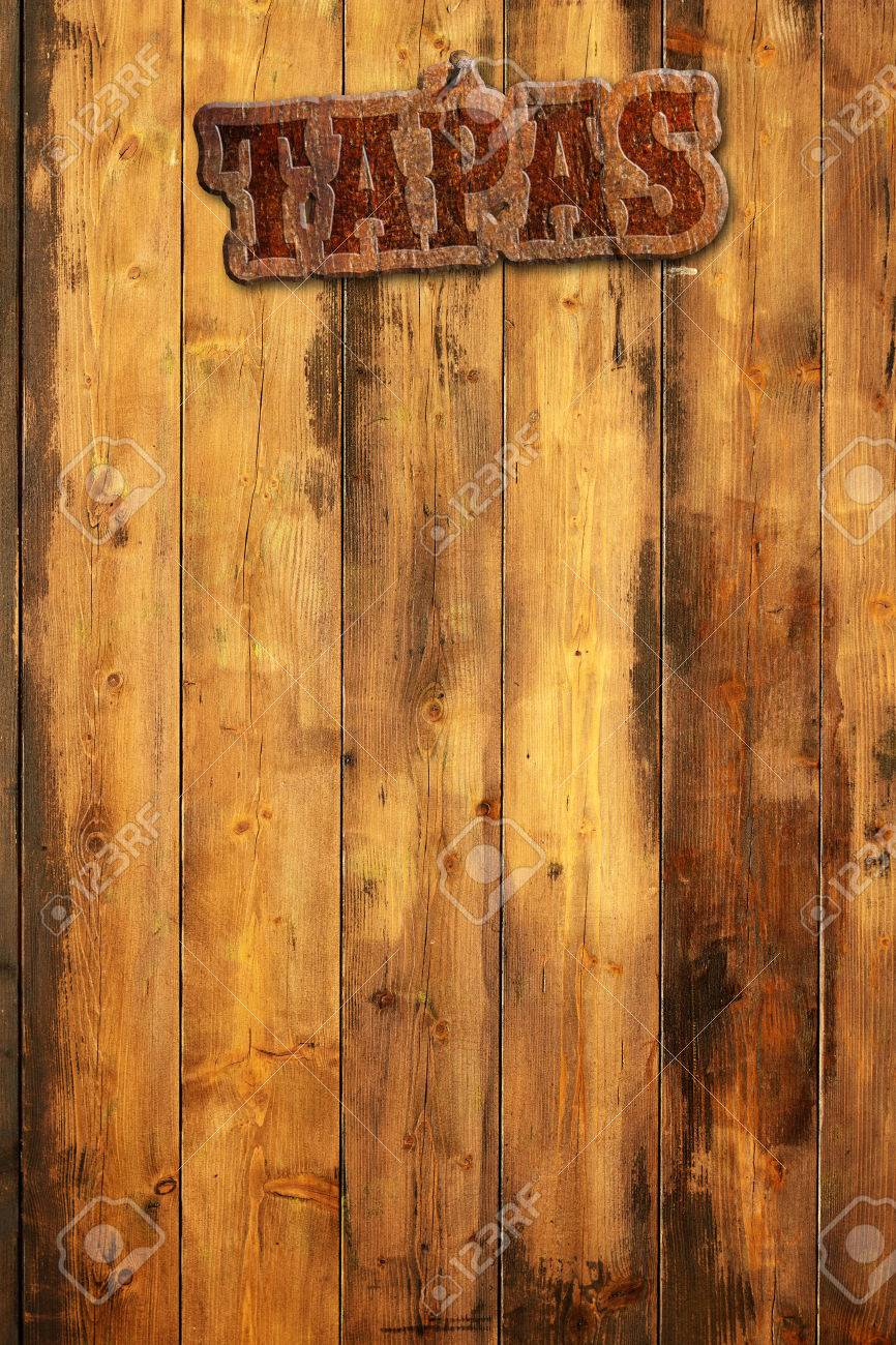 tapas signboard nailed to a wooden wall - 45290583