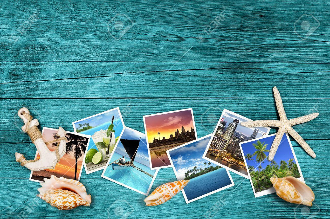 Travel Photos And Seashells On Azure Wood Background Stock Photo