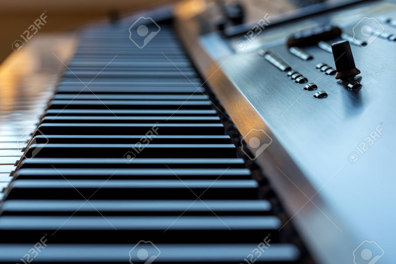 Midi keyboard synthesizer piano keys closeup for electronic music