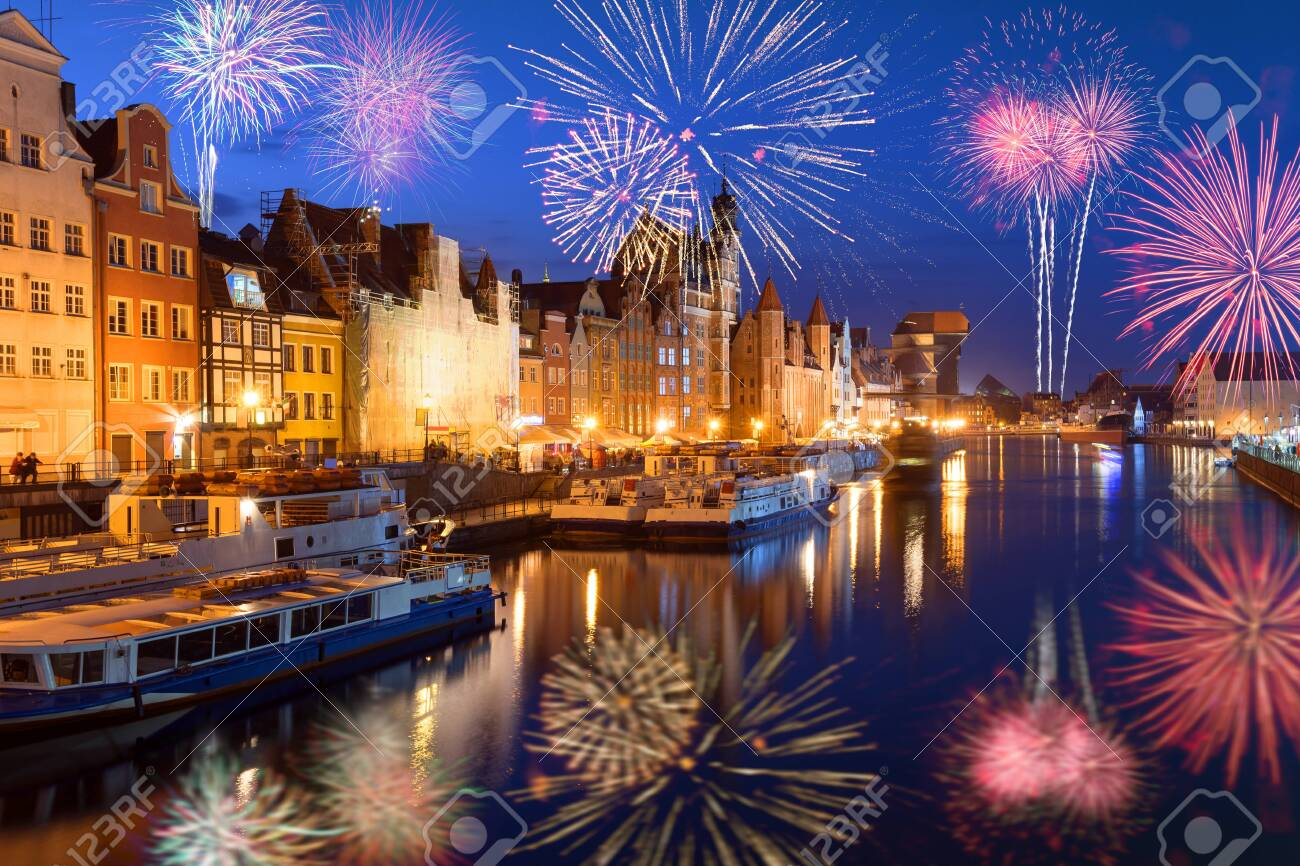 Happy New Year fireworks over Old Town of Gdansk. Poland, Europe - 135585120