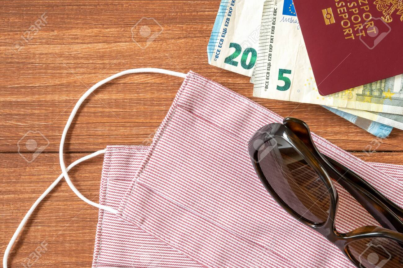 Virus protective mask and international Polish passport. Travel concept, tourism care, corona virus disease. - 145584378