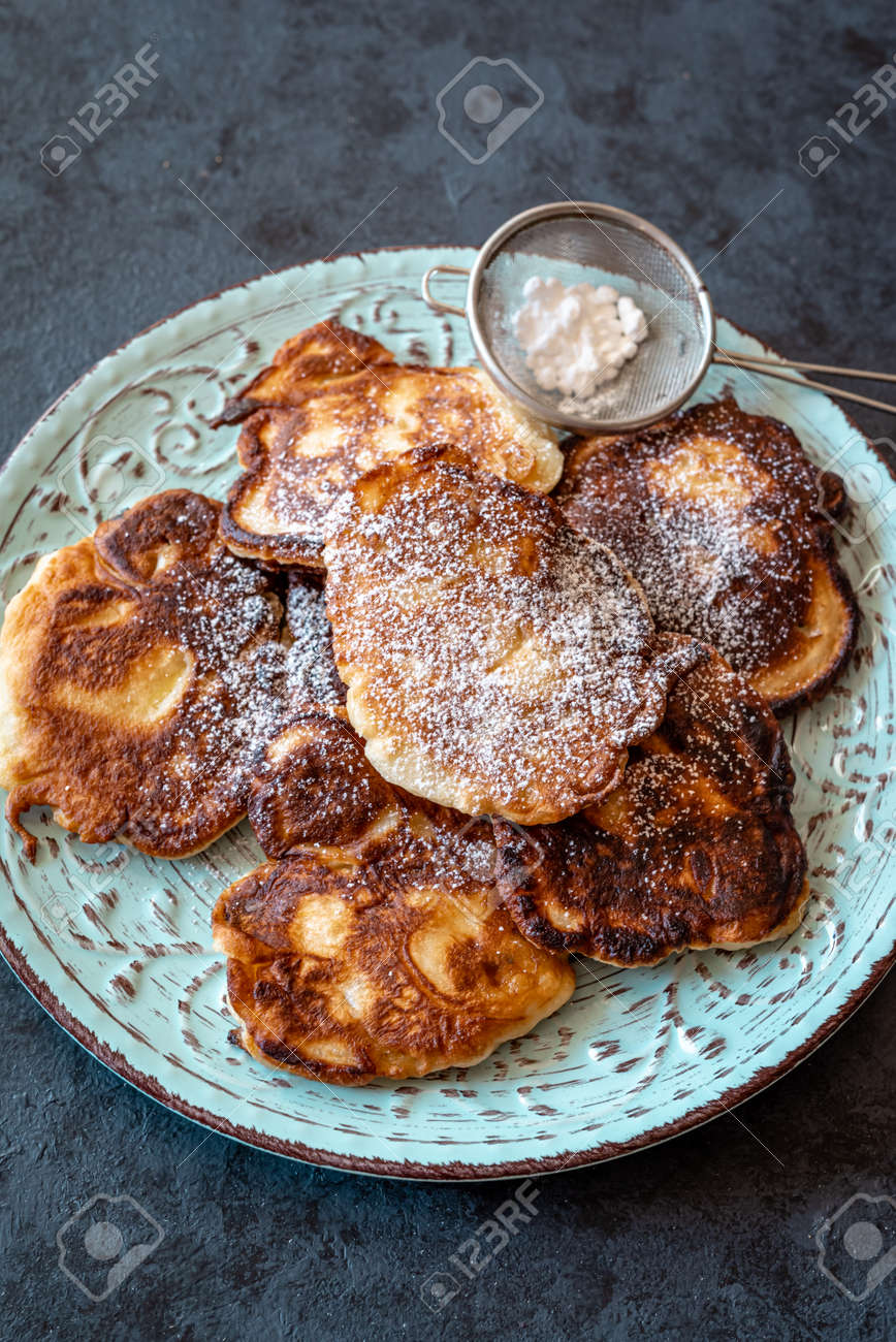 Racuchy - traditional Polish yeast pancakes dusted with icing sugar - 169388217