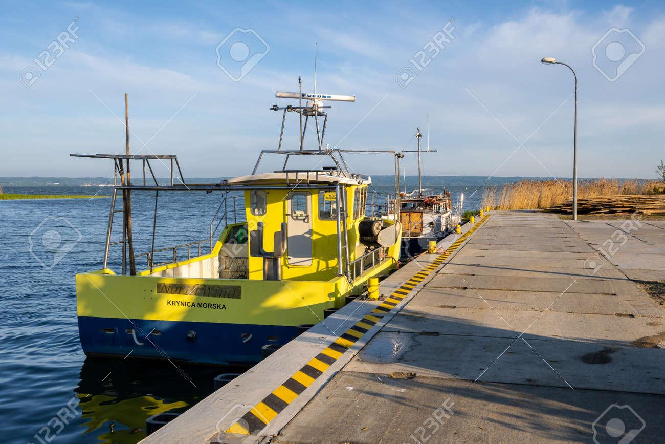 Krynica Morska, Poland - May 15, 2021: The wharf in the fishing port in Krynica Morska on Vistula Spit. Baltic Sea - 169381680