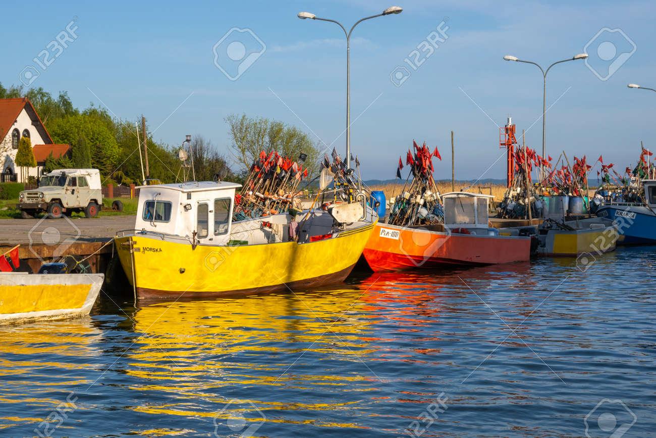 Krynica Morska, Poland - May 15, 2021: Fishing boats docked in port of Krynica Morska on Vistula Spit. Baltic Sea - 169381682